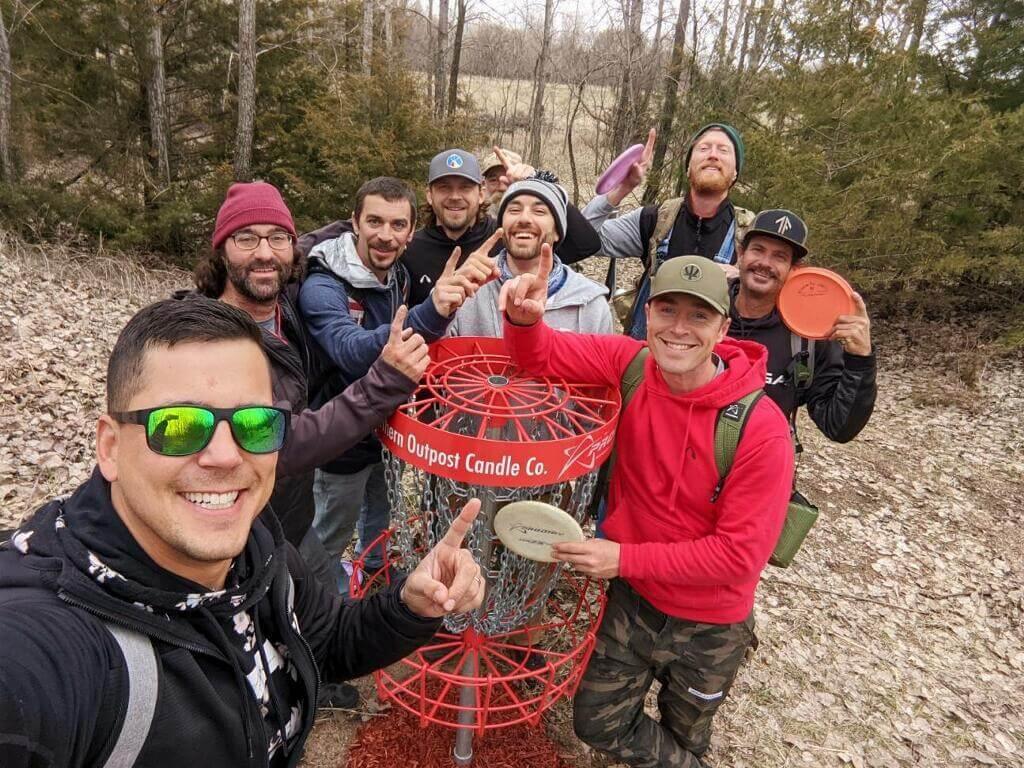 Group around disc golf basket