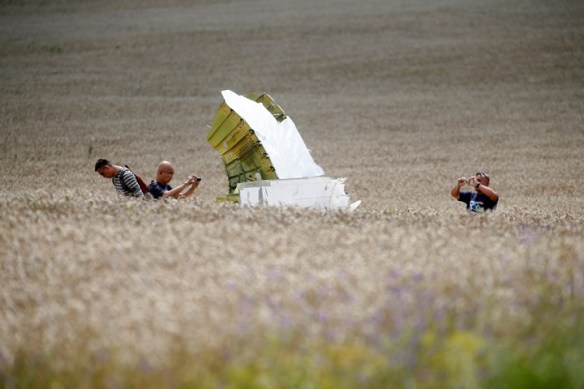 20140717.. MH17 debris and investigators in wheat field 7-22-14