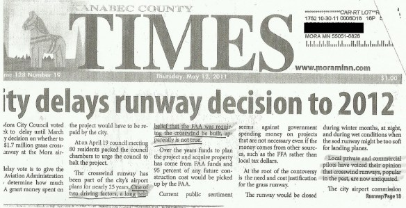 KJMR.20110512.. 'City Delays Runway Decision to 2012' (KanabecCountyTimes, front page)