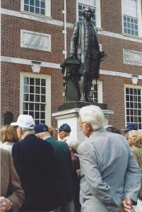 Members in front of statue