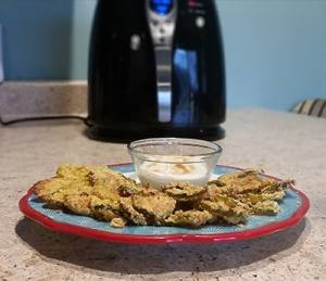 finished air fried pickles with ranch dressing