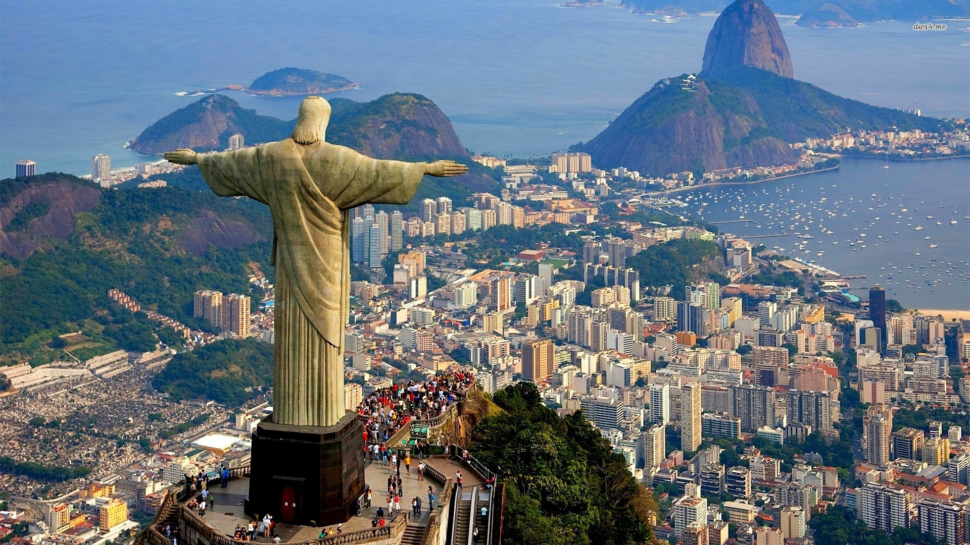 Statue of Christ the Redeemer looking down at Rio de Janeiro