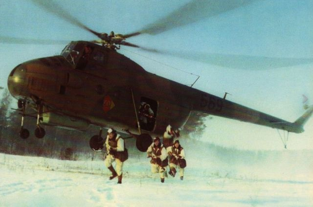 East German paratroopers jumping from a Mi-4 helicopter. Pin by Paolo Marzioli   Military, Military history, Military helicopter