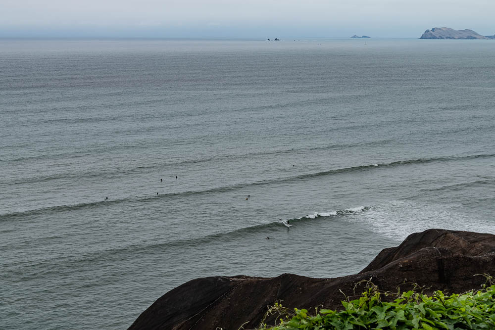 surfers in lima