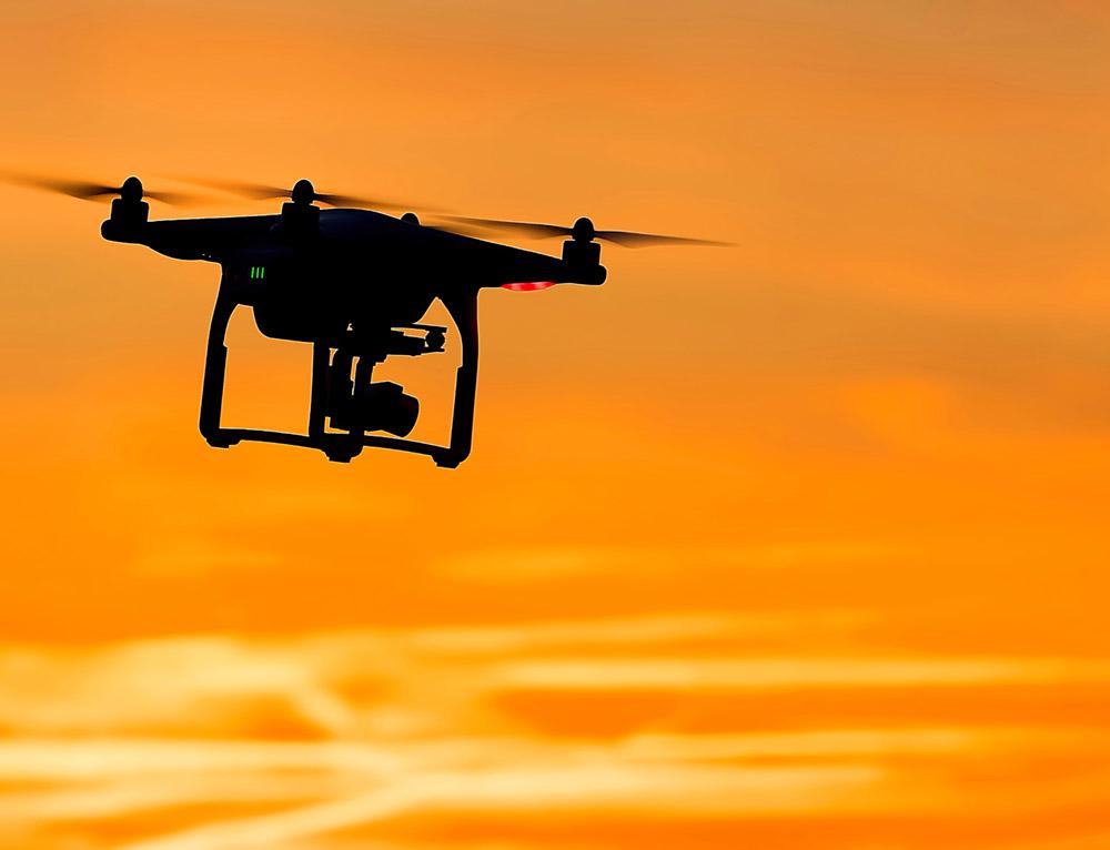 drone flying through orange sky