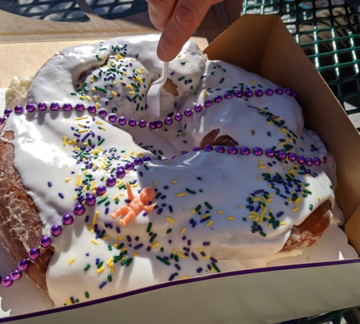 eating a king cake with a spoon