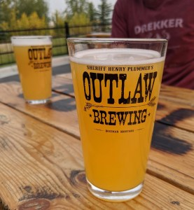 beers on the patio at Outlaw Brewing