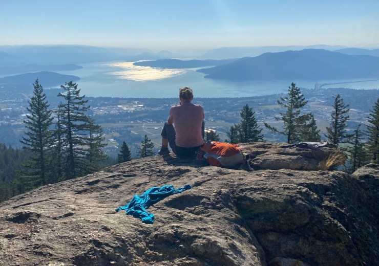 sitting at the top of mickinnick trail in sandpoint
