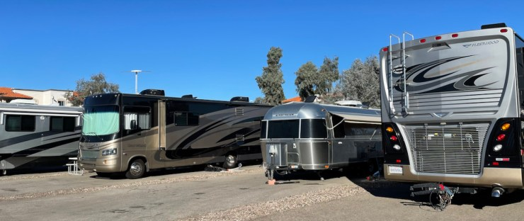 small Airstream and big buses at Sentinel Peak RV Park