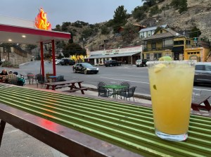 a drink on the patio at Screaming Banshee Pizza