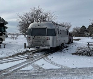 the Airstream in the snow in Fort Stockton