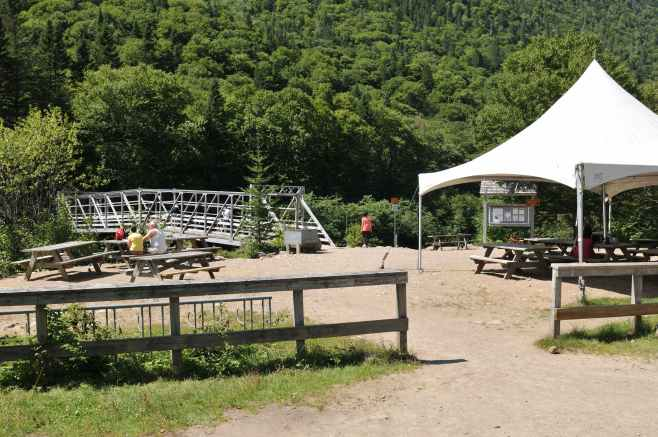After driving 12K up a gravel road, you find a steel bridge and covered picnic tables. There are rapids below, where you can watch canoers and kayakers try to make the turns.
