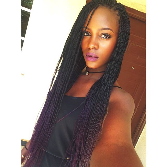 Pretty African girl from Nigeria poses in long dreads