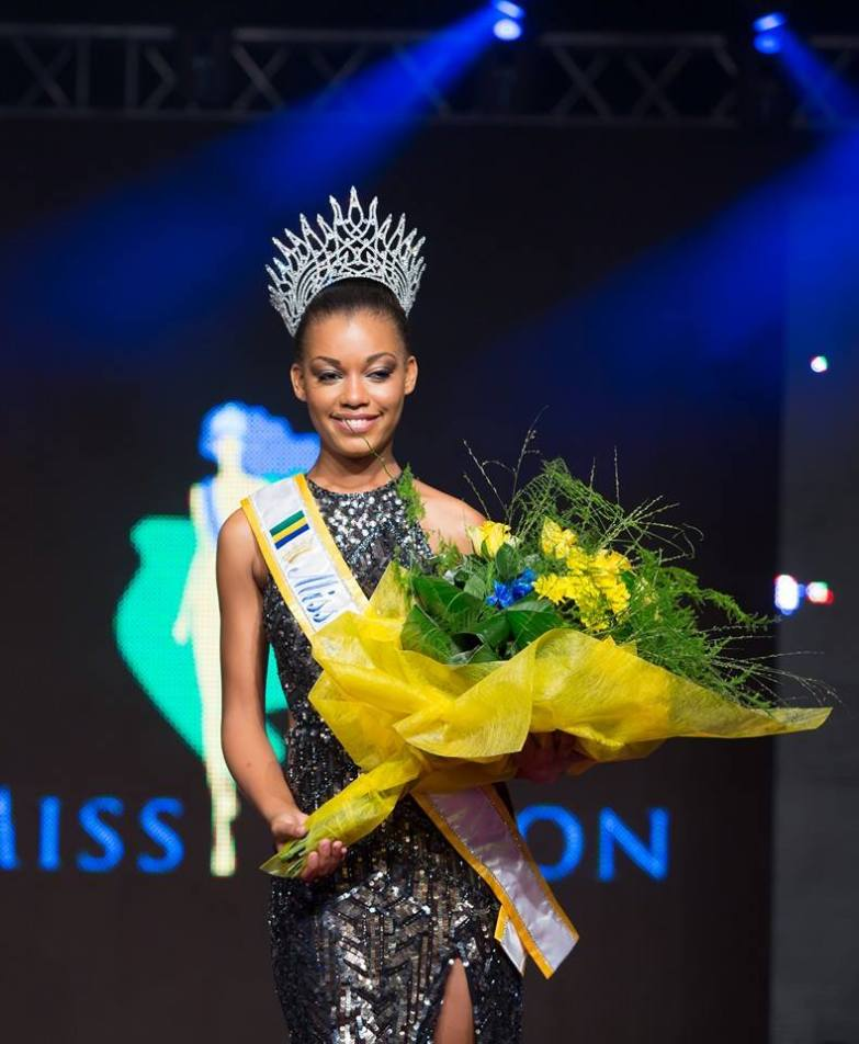 18 Year Old Reine Nogotala Crowned Miss Gabon 2015 - Holds Flowers