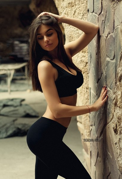 A sexy, slim and curvy Russian Woman in tight pants and crop top - amazing body