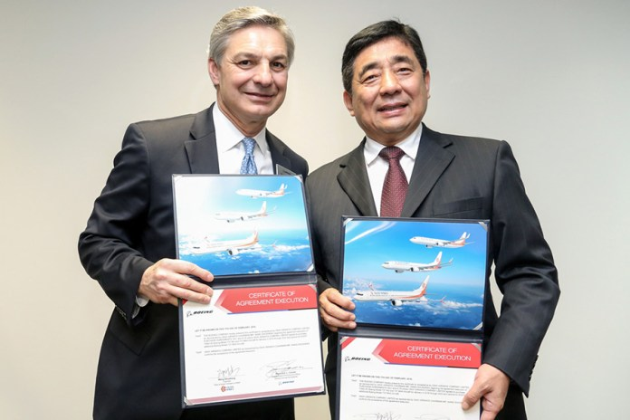Ray Conner, president and CEO, Boeing Commercial Airplanes (left) and Wang Shusheng, Chairman, Okay Airways (right) pose for a photo during a signing ceremony in Singapore. (Credits: Boeing)