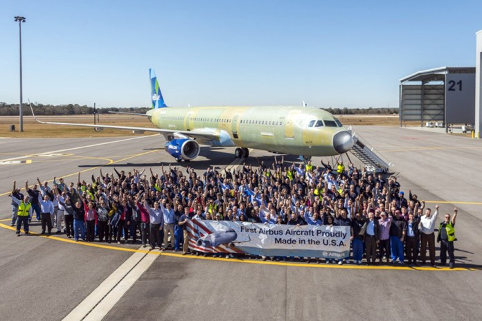 The Airbus Alabama team posing in front of the first US-built A320 family aircraft. (Credits: Airbus)
