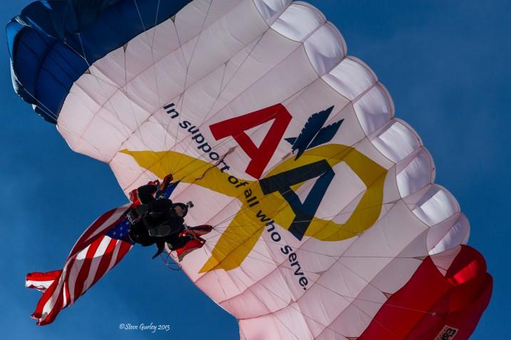sky diver with flag