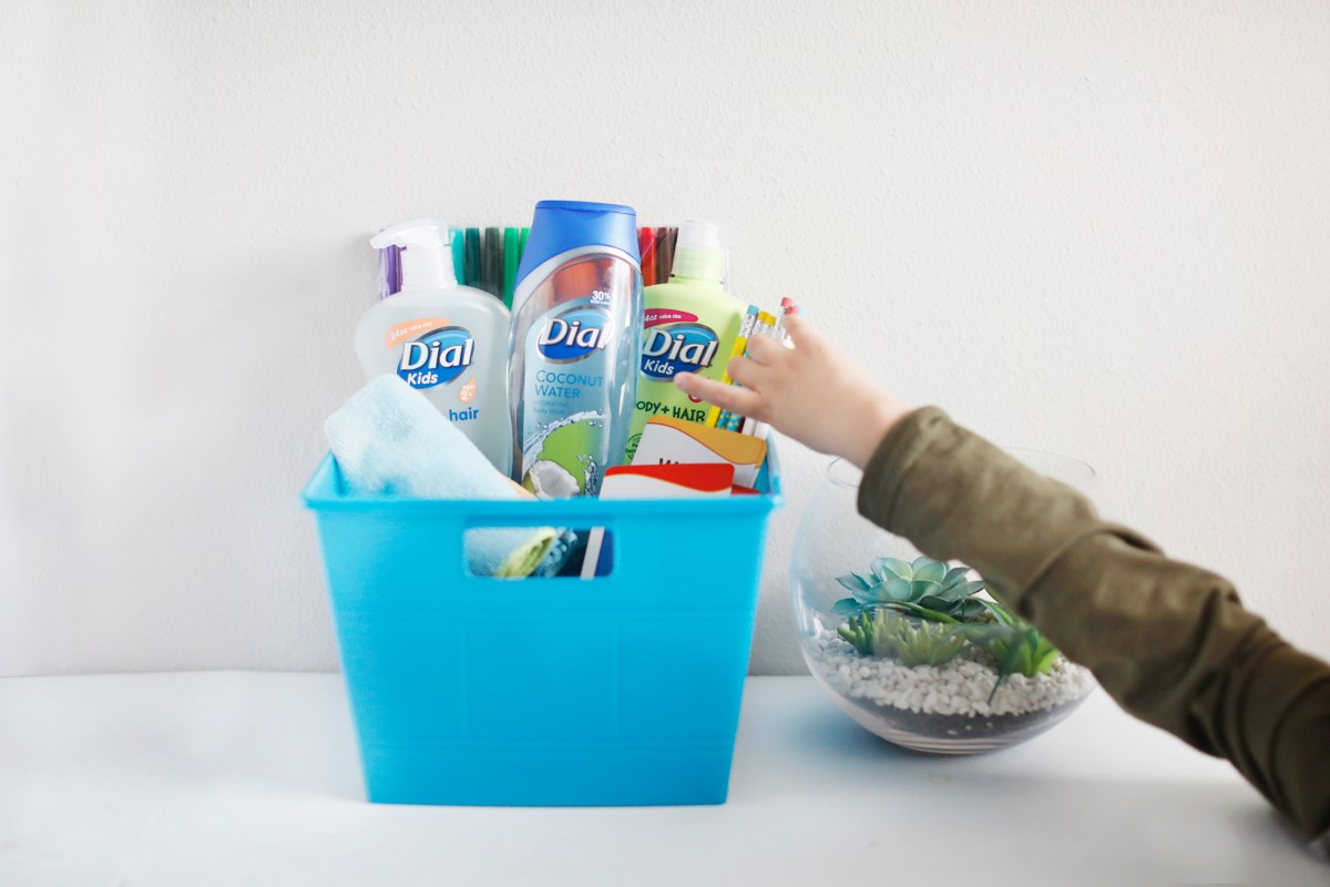 boy reaching for back to school basket