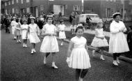 Ann taking part in the local parish Whit Walk, 1950s. Mary had had mixed feelings about Ann taking part in the bigger Manchester Whit Walk as she (Mary) had faced abuse from Protestant children when she joined them as a child. In the end though, Ann had chickenpox on the day and had to stay home.