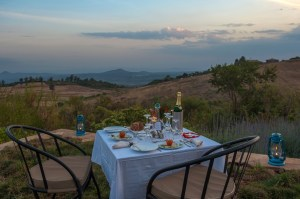 Dining outside Rhotia Valley Lodge