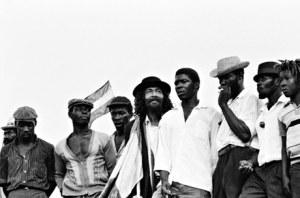 Jamaican rude boys await the arrival ofHaile Selassie
