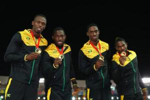 Usain Bolt, Jason Livermore, Kemar Baily-Cole, and Nickel Ashmeade with gold medal.