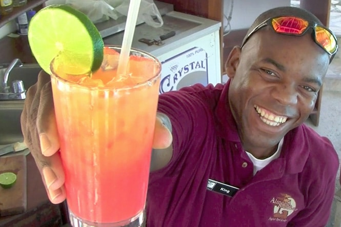 man offering carribean rum punch