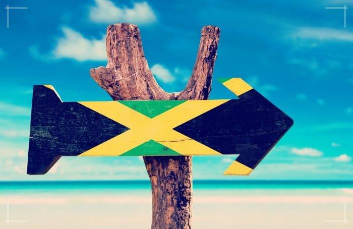 jamaica flag wooden sign on beach