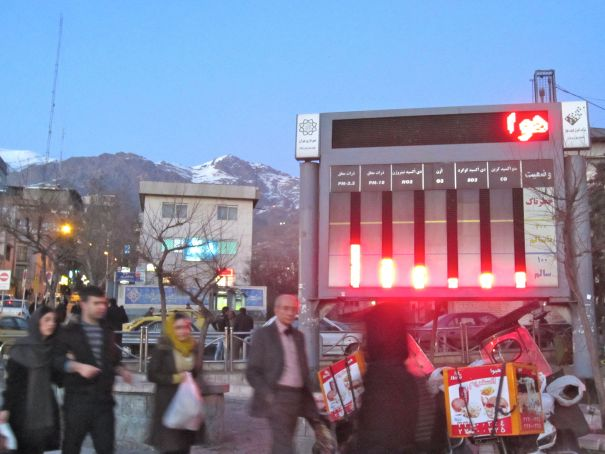 "An electronic display monitors air quality in Tajrish Square, north Tehran. The screen displays levels of various toxins in the air alongside reminders to utilize public transportation. The word at the top is the beginning of a reminder, though so far only the war ""air"" is visible."