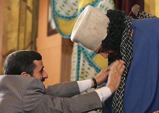 "Ahmadinejad ceremoniously puts a chaffiyeh around ""Cyrus."""