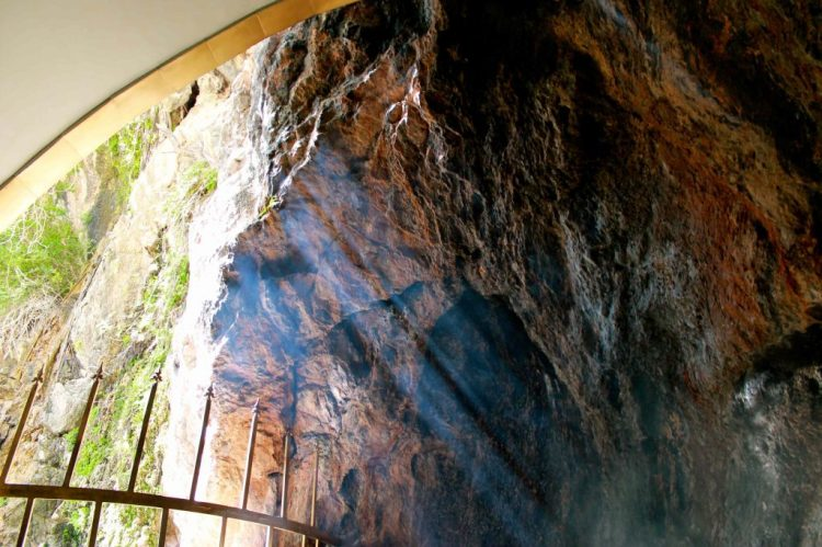 A beautiful ray of sun shines inside the cave of Chak Chak where drops of water fall upon the marble floor.