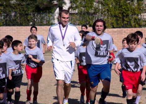 With Armenian children at his Pasadena Soccer Camp, 2011.