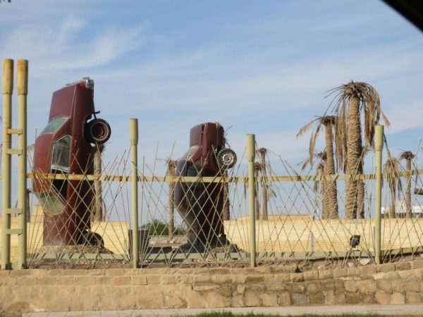 Khorramshahr is home to a major international port, and when Saddam's forces captured the city in the Iran-Iraq war, they took leftover car shipments and planted them in the ground to serve as a anti-paratrooper emplacements. Some of them are still preserved in the city.