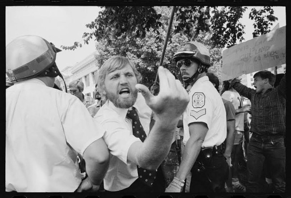 Man heckles Iranians demonstrating for Khomeini at police line in Washington D.C., 1980 (Warren K. Leffler / Library of Congress).
