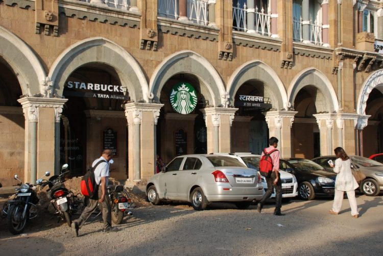 Mumbai Starbucks emblazoned with the logo of TATA, one of the world's largest companies that was founded and is still by local Parsees.
