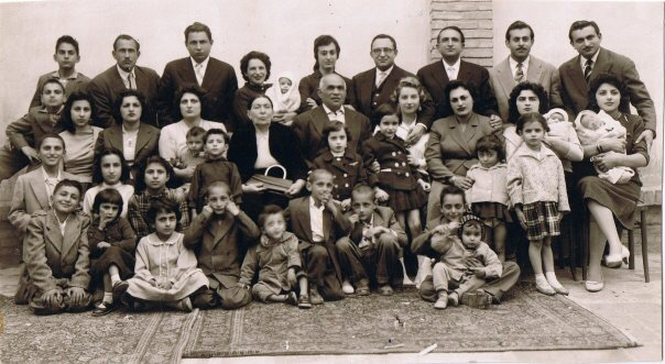 Portrait of a Tehrani Jewish Family Commemorating the Return of their Son and his French wife from Paris, 1954. Anonymous. Ajam Digital Archive, http://www.ajammc.com/