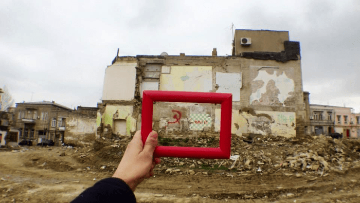 """A hammer and sickle and """"Lenin"""" graffiti spray-painted on a wall of a soon to be demolished home in Sovetski. Many residents of Baku have nostalgic feelings for the Soviet period."""
