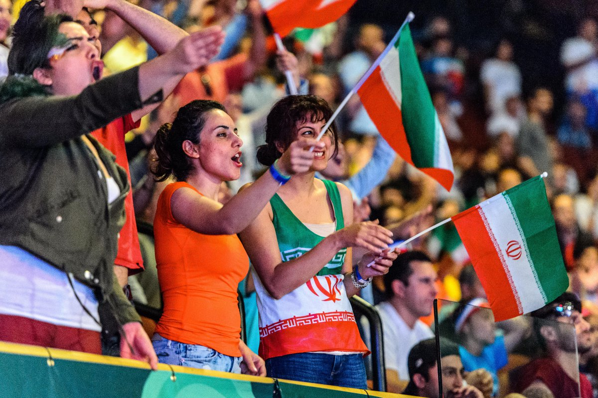 Iranians cheer on the Iran team at the 2016 Freestyle Wrestling World Cup in Los Angeles. Photo: UWW