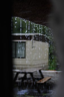 image of a house obscured by falling rain