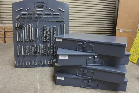 1000 piece spring assortment with metal wall display and metal drawers