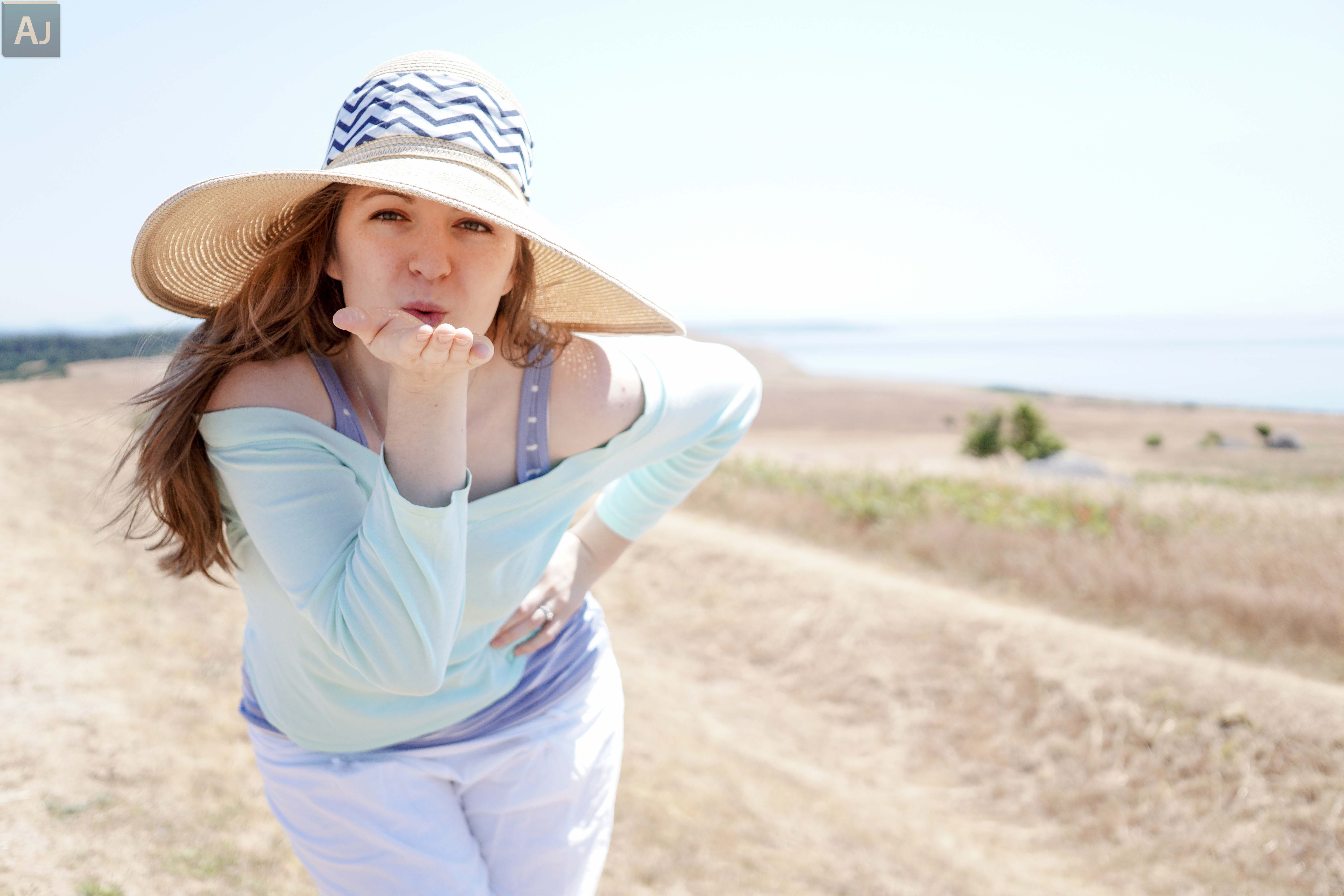 stock photo a little kiss and big summer hat 80085863