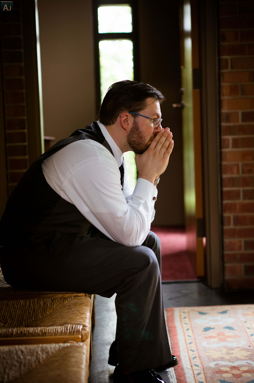 stock photo the pensive praying groom 78801731