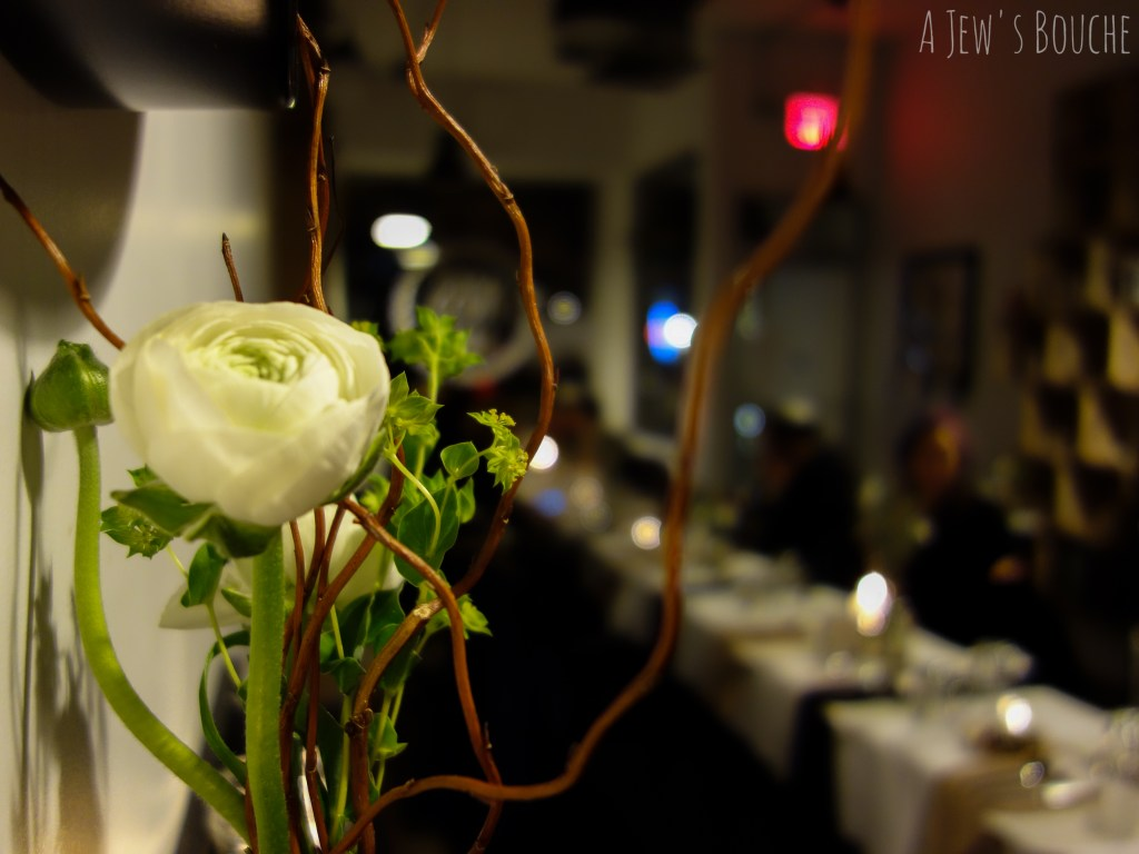 Moss Café's bustling atmosphere transforms into an intimate dinner setting.