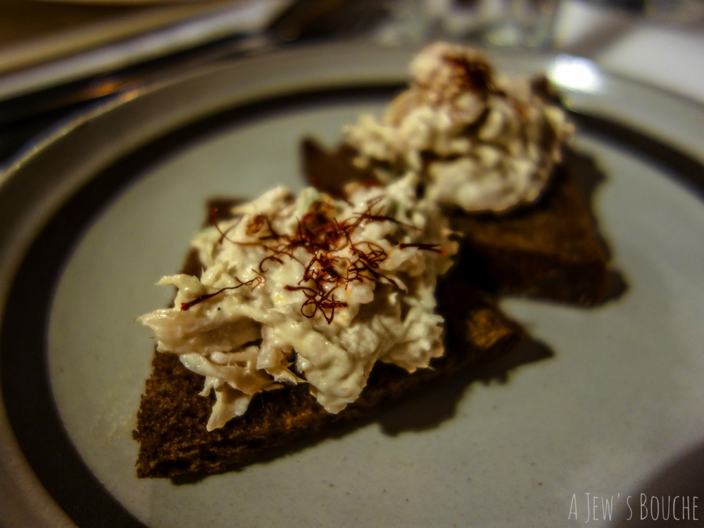 Smoked white fish tartine with saffron on pumpernickel