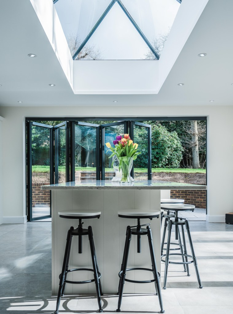 A central lantern roof is the centrepiece of this kitchen extension in Bexhill, East Sussex by AJ Hammond Builders