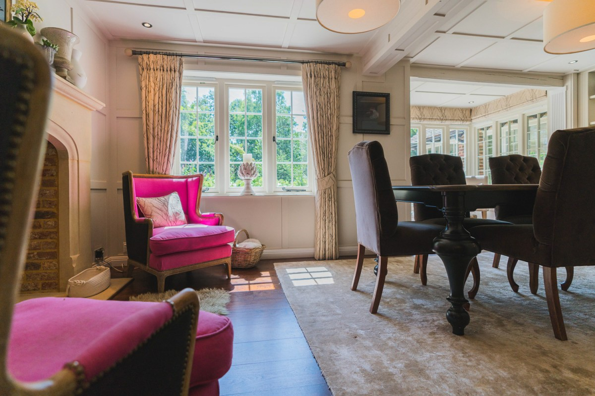 Beautiful decor of a family house renovation with lounge chairs and dining table in East Sussex