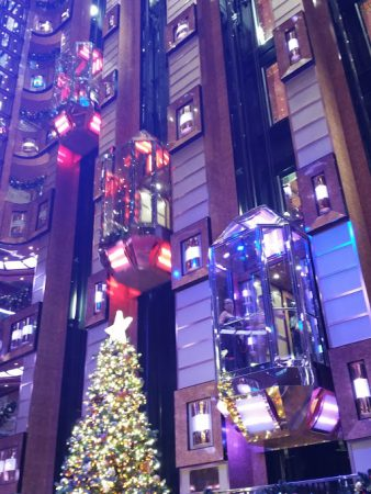 Love the glass elevators with festive lights that change color