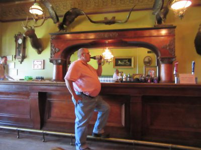 Jim having a drink in the Long Branch Saloon