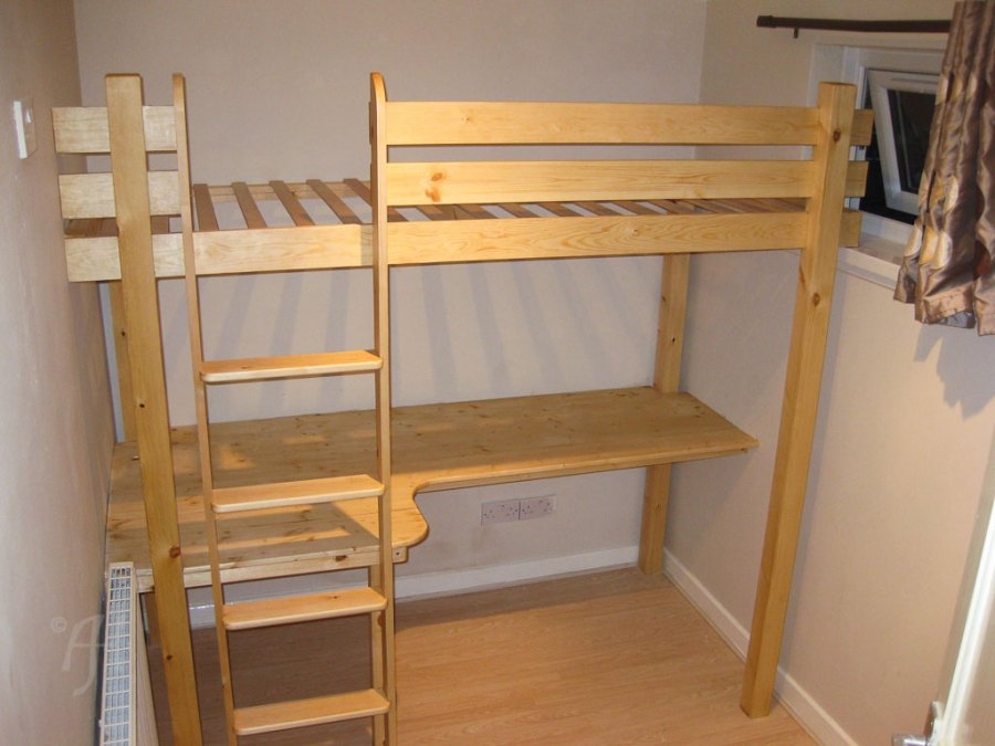 Single bunk bed above a desk